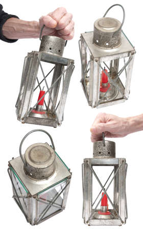 Antique lantern or storm lamp in 4 different positions  against a white background