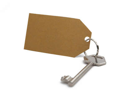 Key with brown paper label against a white background.
