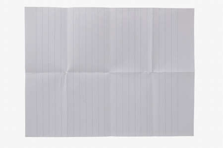 White notebook paper with rules against a white background. It looks like it has been folded.