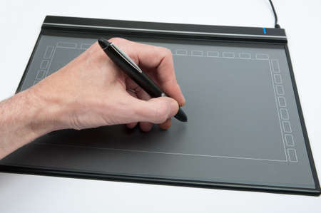 Workflow, male hand on a tablet used by designers.