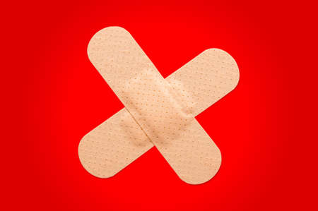 First aid plasters against a red background