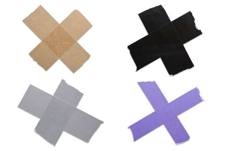 X mark out of different sorts of construction and packaging tape against a white background