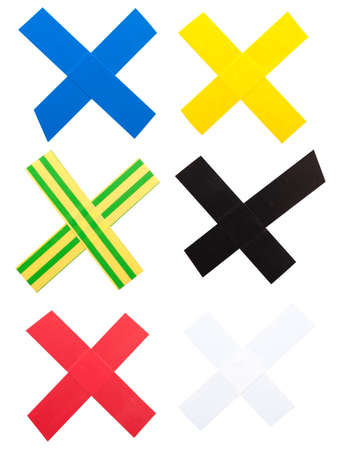 Several XMarks out of color tape against a white background.