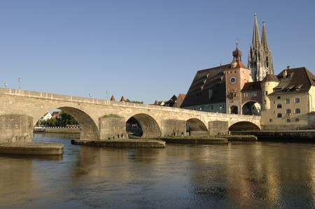 the famous old bridge and kathedral of Regensburg in Germany photo