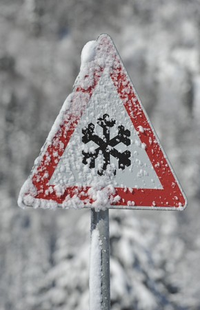 a sign warns against danger of avalanche and snow photo