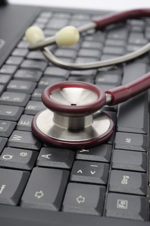 medicine stethoscope on a computer keyboard photo