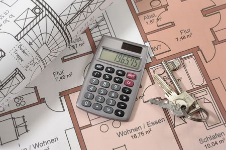 House building plan with hand calculator and keys photo