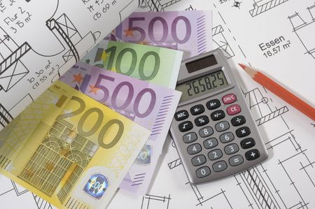 House building plan with hand calculator and money euros photo