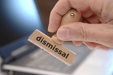 dismissal: wooden stamp with inscription dismissal Stock Photo
