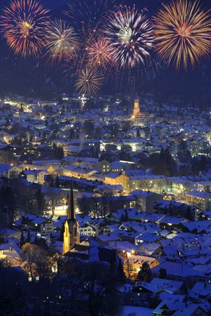 night fireworks: famous town garmisch-partenkirchen in germany at new year with firework Stock Photo