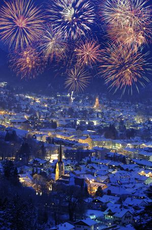 famous town garmisch-partenkirchen in germany at new year with firework photo