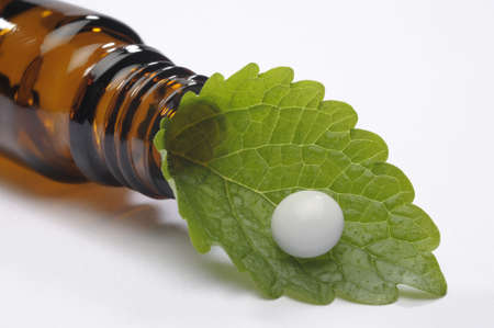 alternative medicine with pill and herbal plant  photo
