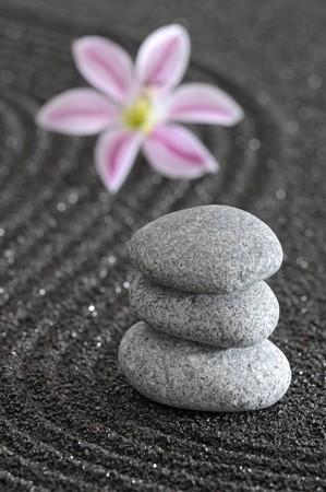 zen garden in black sand photo
