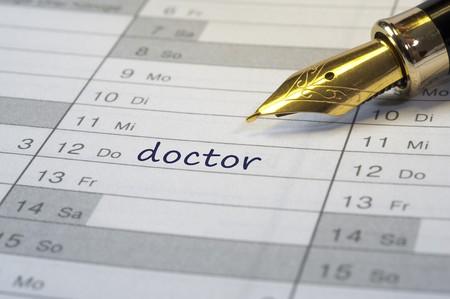 appointment book: doctor date written in calendar