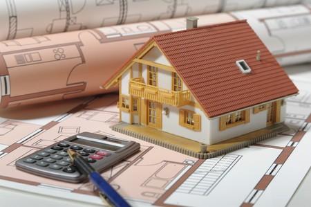 model house on blue print plan photo