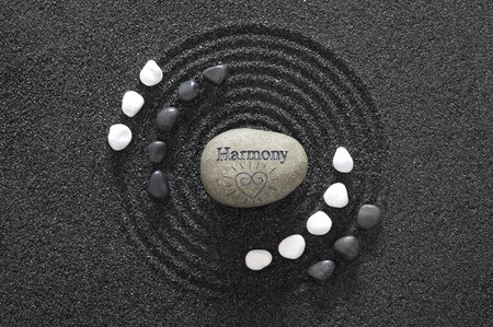 zen garden in black sand and stone of harmony photo