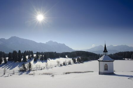 chapel in winter in upper bavaria, germany photo