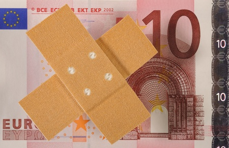 wound plaster and euro banknote photo