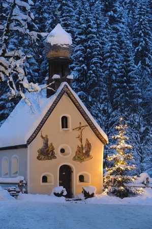 christmas chapel and illuminated tree at eve night in upper bavaria, germany Stock Photo - 8826411