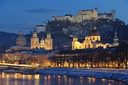 illuminated city salzburg in Austria at christmas night photo