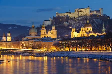 illuminated city salzburg in Austria at christmas night Stock Photo