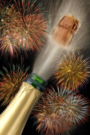 happy new year with popping champagne photo