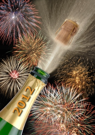 happy new year 2012 with popping champagne photo