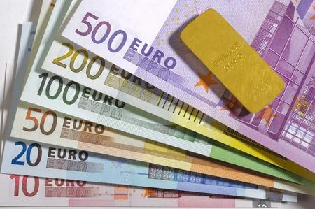 euro banknotes and gold bar photo