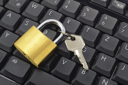 padlock on computer keyboard photo