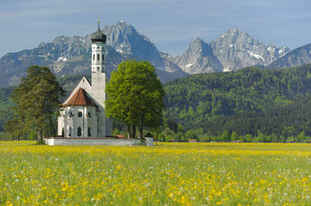 landmark church St. Coloman in Bavaria, Germany, at springtime photo
