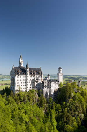 ludwig: NEUSCHWANSTEIN, BAVARIA, GERMANY - JUNE 5: Historic castle Neuschwanstein of bavarian king Ludwig II, nearby city Fuessen at alps mountains and lake Forggensee. Photo taken on June 5, 2010 in Neuschwanstein, Germany
