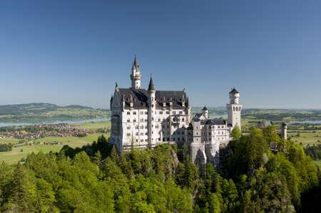 NEUSCHWANSTEIN, BAVARIA, GERMANY - JUNE 5: Historic castle Neuschwanstein of bavarian king Ludwig II, nearby city Fuessen at alps mountains and lake Forggensee. Photo taken on June 5, 2010 in Neuschwanstein, Germany