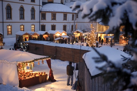 ETTAL, BAVARIA, GERMANY - DECEMBER 4: The traditional annual christmas market with illuminated shops at night in famous 700 years old benedictine abbey Ettal, nearby city Oberammergau and Garmisch, December 4, 2010 in Ettal, Germany Stock Photo - 9649285