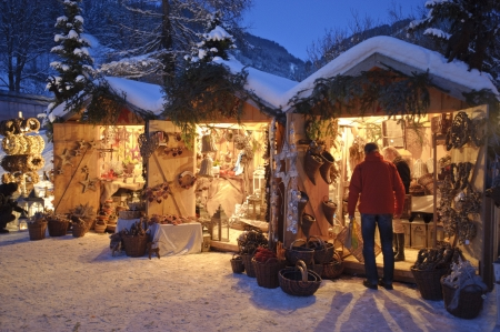 ETTAL, BAVARIA, GERMANY - DECEMBER 4: The traditional annual christmas market with illuminated shops at night in famous 700 years old benedictine abbey Ettal, nearby city Oberammergau and Garmisch, December 4, 2010 in Ettal, Germany Stock Photo - 9649289