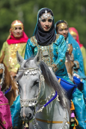 cavalry: MUNICH, GERMANY - JUNE 4:  female members of the arabian -Royal Cavalry of Oman- while a public show at the equestrian challenge -Pferd International 2011-, at June 4, 2011 in Munich, Germany Editorial