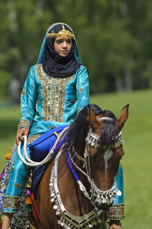 MUNICH, GERMANY - JUNE 4:  female member of the arabian -Royal Cavalry of Oman- while a public show at the equestrian challenge -Pferd International 2011-, at June 4, 2011 in Munich, Germany