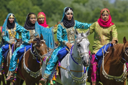 MUNICH, GERMANY - JUNE 4:  female members of the arabian -Royal Cavalry of Oman- while a public show at the equestrian challenge -Pferd International 2011-, at June 4, 2011 in Munich, Germany