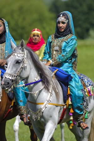 MUNICH, GERMANY - JUNE 4:  member of the arabian -Royal Cavalry of Oman- while a public show at the equestrian challenge -Pferd International 2011-, at June 4, 2011 in Munich, Germany