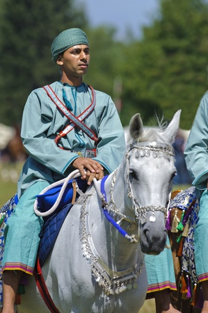 cavalry: MUNICH, GERMANY - JUNE 4:  member of the arabian -Royal Cavalry of Oman- while a public show at the equestrian challenge -Pferd International 2011-, at June 4, 2011 in Munich, Germany Editorial
