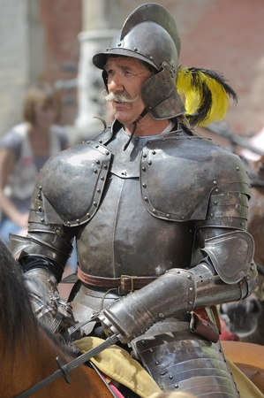 ROTHENBURG OB DER TAUBER, GERMANY - JUNE 12: performer dressed in historical armor as knight while the annual medieval parade -Meistertrunk- at June 12, 2011 in Rothenburg ob der Tauber, Germany