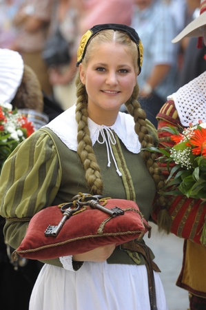 ROTHENBURG OB DER TAUBER, GERMANY - JUNE 12: young girl as performer of the annual medieval parade -Meistertrunk-, dressed in historical costume at June 12, 2011 in Rothenburg ob der Tauber, Germany Stock Photo - 9716283