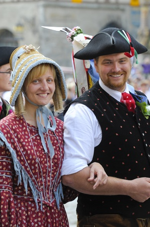 ROTHENBURG OB DER TAUBER, GERMANY - JUNE 12: performer of the annual medieval parade Meistertrunk, dressed in historical costume while an ancient dance at June 12, 2011 in Rothenburg ob der Tauber, Germany