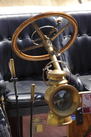 LANDSBERG, GERMANY - JULY 9: Oldtimer rallye for at least 80 years old antique cars with lamp and steering wheel, photo taken on July 9, 2011 in Landsberg, Germany