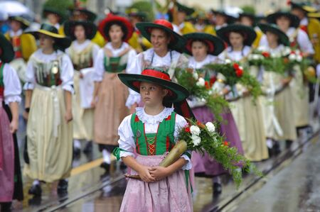 MUNICH, GERMANY - September 18:  public opening parade of world biggest beer folk festival oktoberfest in munich with 9000 performers and  girls in historical costumes, at September 18, 2011 in Munich, Germany
