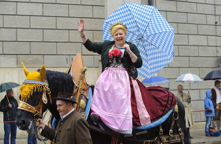 MUNICH, GERMANY - September 18: opening parade of world biggest beer folk festival oktoberfest in munich with 9000 performers and a woman on horse in typical bavarian dress, at September 18, 2011 in Munich, Germany