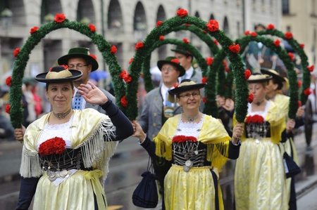 MUNICH, GERMANY - September 18:  public opening parade of world biggest beer folk festival oktoberfest in munich with 9000 performers and dancing girls in historical costumes, at September 18, 2011 in Munich, Germany
