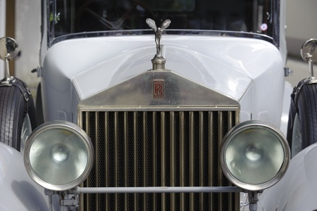 phantom: LANDSBERG, GERMANY - JULY 9: Oldtimer rallye for at least 80 years old antique cars with Emily on Rolls Royce Phantom, built at year 1928, photo taken on July 9, 2011 in Landsberg, Germany Editorial