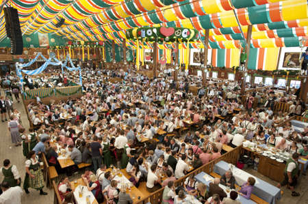 MUNICH, GERMANY - SEPTEMBER 21: overview in  the tent of Loewenbraeu brewery at world biggest beer festival -Oktoberfest in Munich- on September  21, 2011 in Munich, Germany