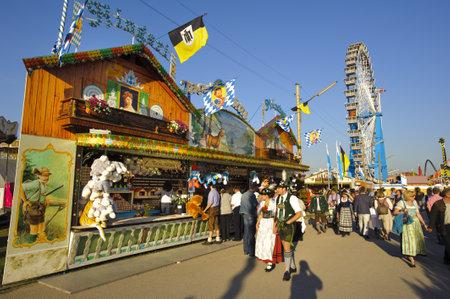 MUNICH, GERMANY - SEPTEMBER 21: amusement hut at world biggest beer festival -Oktoberfest in Munich- on September  21, 2011 in Munich, Germany