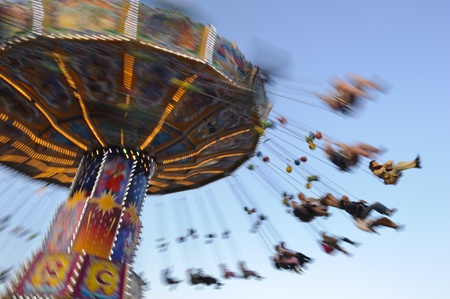 MUNICH, GERMANY - SEPTEMBER 21: carousel with flying people at world biggest beer festival -Oktoberfest in Munich- on September  21, 2011 in Munich, Germany
